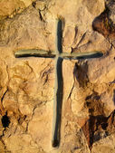 Tombstone cross carved on the stone — Stock Photo