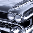 Front end of classic car - Stock Photo