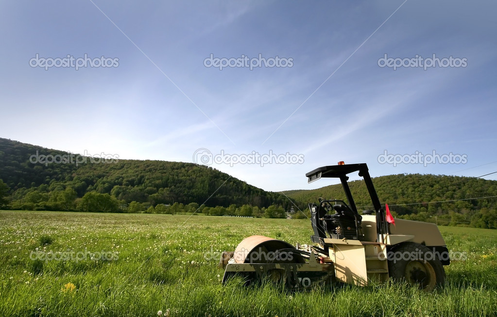 Single construction equipment in the middle of farm — Stock Photo #7988848