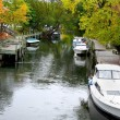 Stock Photo: Boats Docked In River