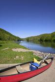 Canoe by the river shore — Stock Photo