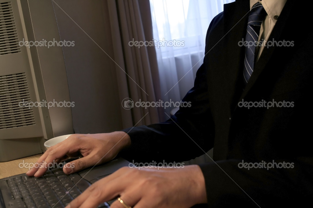 Business man typing on laptop in office — Stock Photo #8043013
