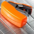 Orange tiny stapler — Stock Photo