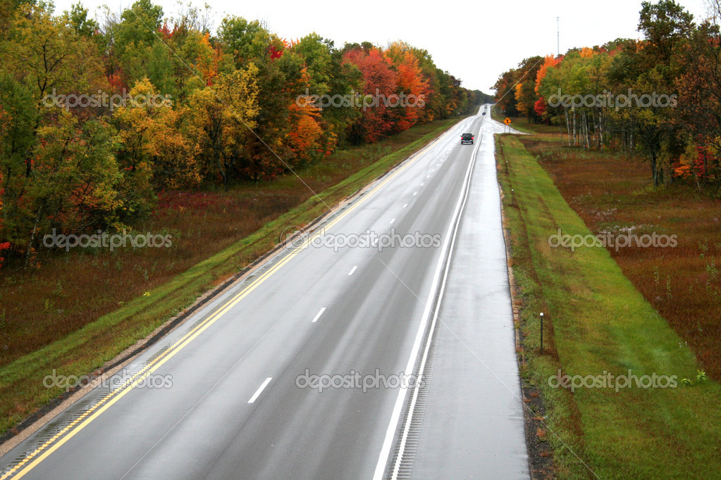 Highway and autumn scene on a rainy day  — Stock Photo #8478620