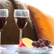 Wine glasses and fruits — Stock Photo