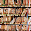 Medical record files in the shelf - Stock Photo