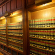 Law books in the shelf's of library — 图库照片
