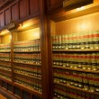 Law books in the shelf's of library — Stock Photo