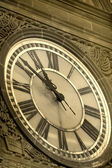 Clock on an ancient building — Stock Photo