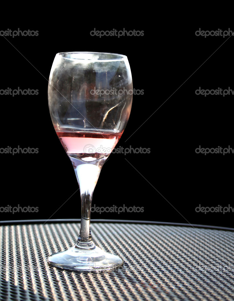 The close up of Wine glass with black ground — Stock Photo #9105218