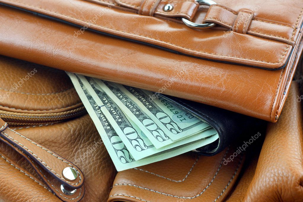 Stack of leather purses with 20 dollar money notes — Stock Photo #9115868