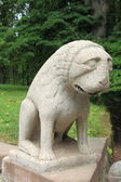 Sculpture of sad lion — Stock Photo