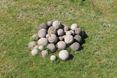 White stone cannonballs — Stock Photo