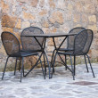 Iron table and chairs — Stockfoto