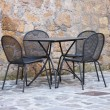 Iron table and chairs — 图库照片