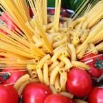 Raw pasta and tomatoes — Stock Photo