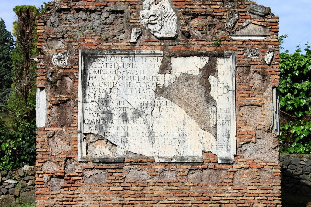 Ancient latin inscription in the Appian way of Rome, Italy — Stock Photo #8518168
