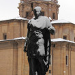 Statue of roman emperor Julius Caesar under snow - Stock Photo