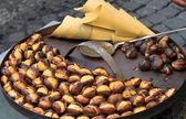 Grilled chestnuts — Stock Photo
