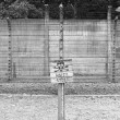 Warning sign at Auschwitz - Stock Photo