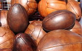 Soccer and rugby balls — Stock Photo