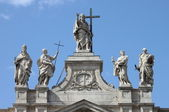 Statues on the top of Saint John Lateran Basilica — Stock Photo