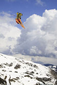 Flying skier on mountains — Stock Photo