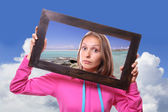 Woman Holding Frame, travel concept — Stock Photo