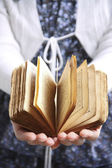 Old book in hands — Stock Photo