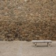 Old stone wall with bench — Zdjęcie stockowe #10584895