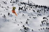 Flying skier on mountains — Stock Photo
