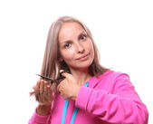 Woman going to cut her long hair — Stock Photo