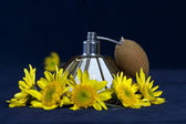 VINTAGE PERFUME BOTTLES and Yellow flower — Stock Photo