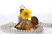VINTAGE PERFUME BOTTLES PEARLS & YELLOW FLOWER — Stock Photo