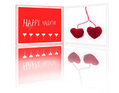 Valentine greeting card with two red fibre hearts — Stock Photo