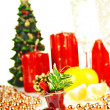 Christmas toys and Christmas tree with candles — Stock Photo #8014678