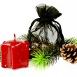 Pine twig with red Christmas candles and gift — Stock Photo #8240311
