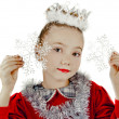 Stock Photo: Little snow maiden with snowflakes
