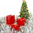 Red Christmas candles and toys — Stock Photo