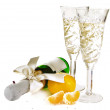 A bottle of champagne and crystal glasses - Stock Photo