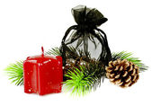 Pine twig with red Christmas candles and gift — Stock Photo