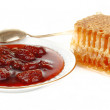 Honeycomb with jam at the plate — Stockfoto
