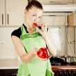 Young woman cooks dinner in the kitchen — Stock fotografie #8363559