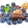 A handful of blueberries and slices of chocolate — Stock Photo