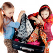 Girl with a suitcase going on a journey — Stock Photo