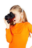 A happy little girl photographs — Stock Photo