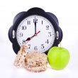 Dietetic loaves with green apple and watches at 8 o'clock — Stock Photo #9065405