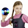 Royalty-Free Stock Photo: Little Schoolgirl with a disk in his hand