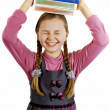 Little Schoolgirl with books in hand — Stock Photo