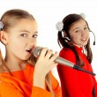Stock Photo: Beautiful girl singing into microphone